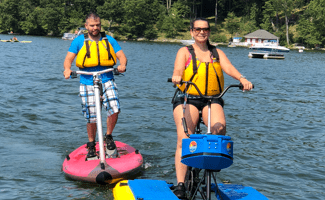 Man and woman enjoying pedaling a hydrobike on Lake Hopatcong