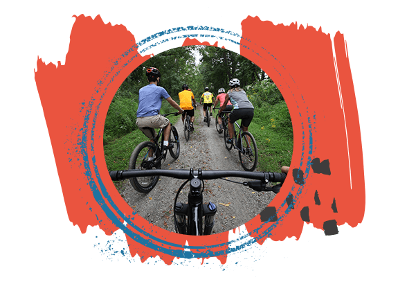 Circular Image of Group Biking on a Trail